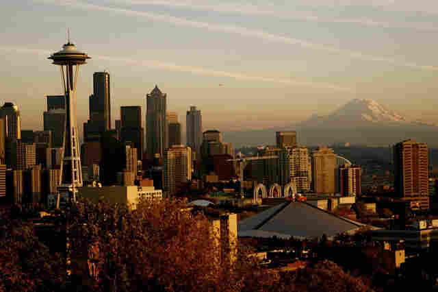 Mount Rainier looms in the background, and the Space Needle (far left) punctuates the city's skyline. Clausen has set three crime novels in Seattle, where he worked as a police officer for 13 years.
