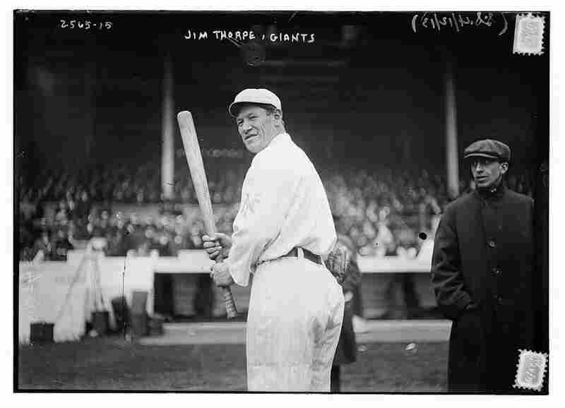 Thorpe poses in his New York Giants baseball uniform in 1913. After losing his amateur status following the Olympic medal scandal, Thorpe turned to baseball to continue his professional athletic career.