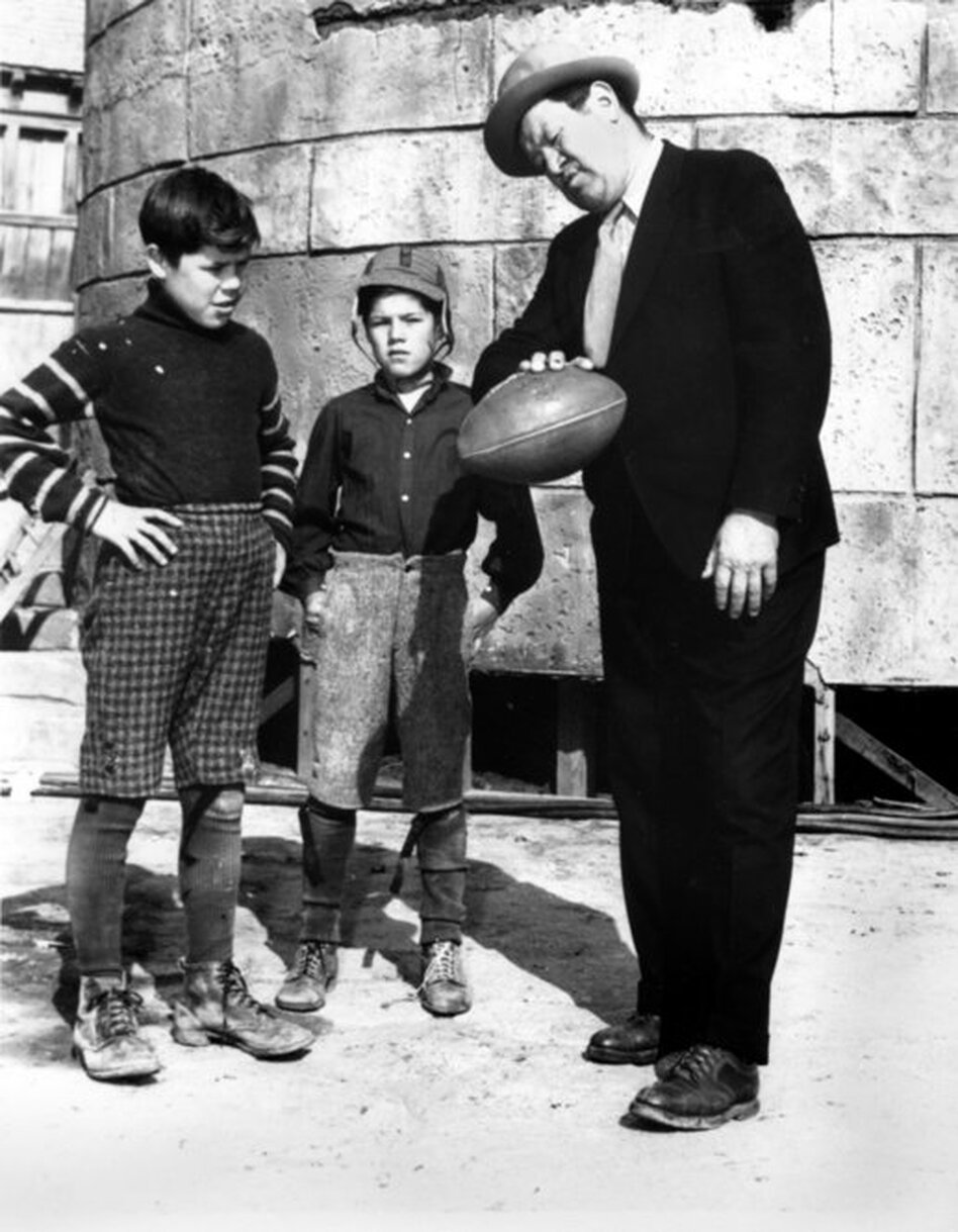Thorpe (right) gives some passing tips to his sons Phil (left) and Bill on a movie set in Los Angeles in 1940. Desperate to make ends meet after his professional sports career, Thorpe set his sights on Hollywood, where he was often cast in movies as an American Indian.  (Hansi Lo Wang, Amanda Steen)