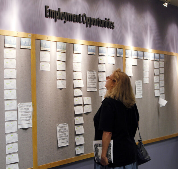 Lori Kamlet looks at posted employment opportunites at a Denver Employment office on Friday, July 22, 2011.
