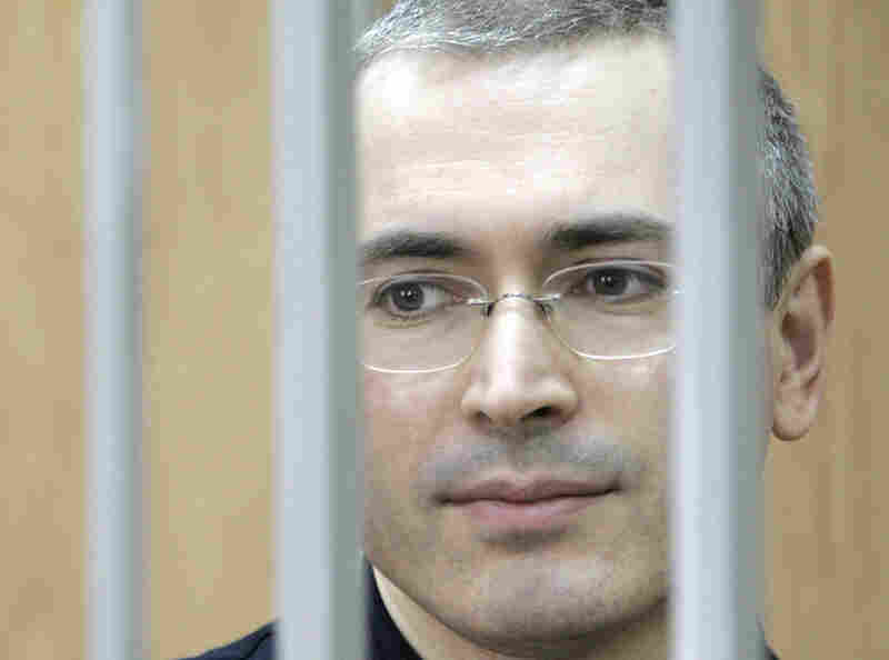 "Mikhail Khodorkovsky, former head of the Yukos oil company and once the richest man in Russia, stands in a defendant's cage in a Moscow courtroom in 2005. He was convicted of fraud and tax evasion, and sentenced to hard labor. The European Court of Human Rights later ruled that use of the cage violated Khordorkovsky's right against ""degrading treatment."""