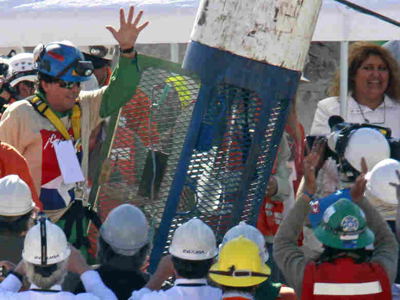Samuel Avalos waves after being rescued at the San Jose mine near Copiapo, Chile, in October 2010. A year after the tragedy, some of the miners are still unemployed and dealing with the mental impact of the collapse.
