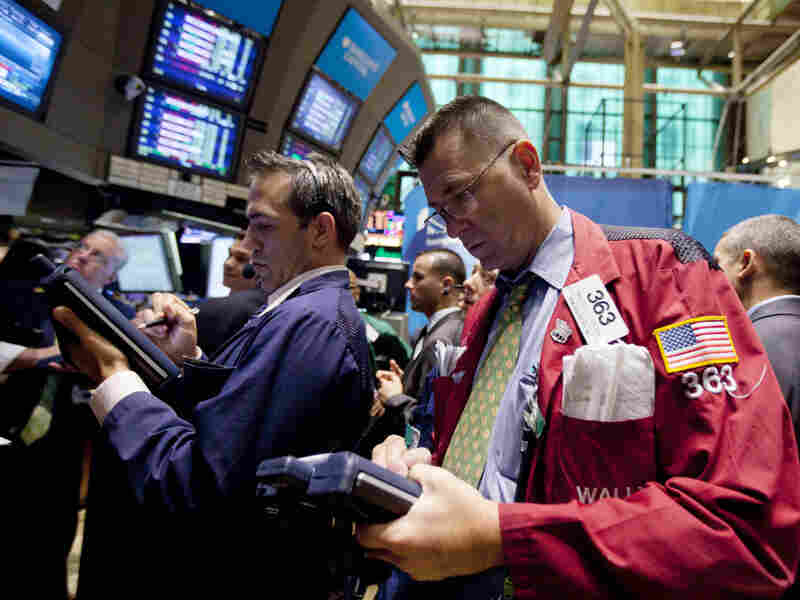 Traders work on the floor of the New York Stock Exchange on Thursday in New York. Stocks are plunging in another broad sell-off as investors grow concerned about an economic slowdown in the U.S. and Europe.