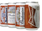 The 12 Cans Of Budweiser: Bud's new design (far right) emphasizes a bow tie. A 1940s version for soldiers (second from left) used olive drab, presumably to blend into combat situations.