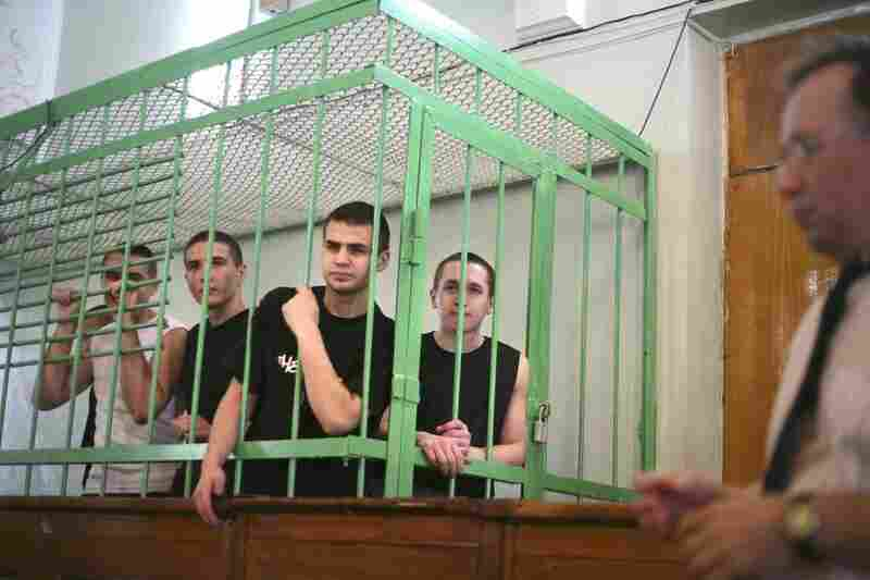 Five Muslim teenagers wait inside a courtroom cage in Kazan, Russia, in 2006. Prosecutors said the teenagers were involved in a failed terrorist plot to disrupt millennial celebrations in the city along the Volga River.