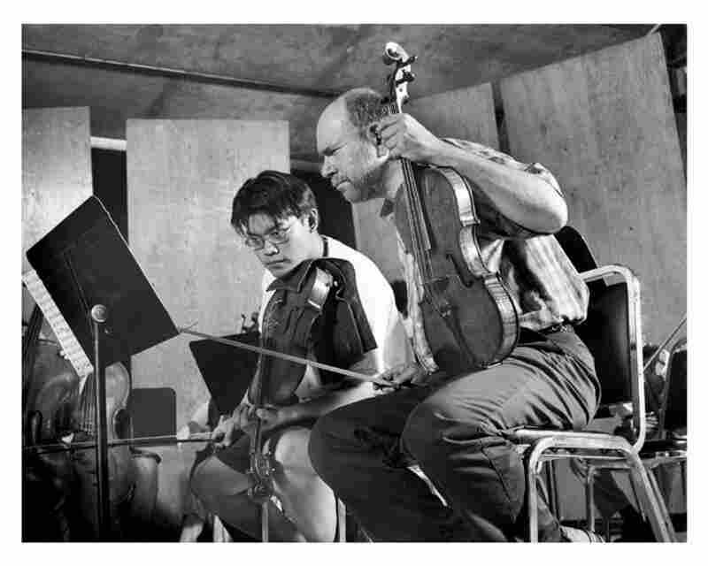 Samuel Rhodes (right) with Brian Chen in 1999.
