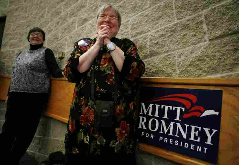 Joni Scotter, considered an uber-volunteer for the GOP, listens to former Massachusetts Gov. Mitt Romney speak in 2007. Now every candidate wants to meet with her ahead of the primary in Iowa; she remains undecided.