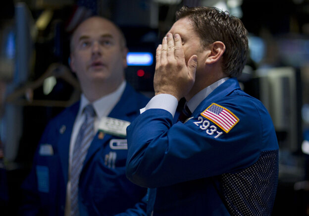 Traders work on the floor of the New York Stock Exchange on Thursday, as stocks plunged in another broad sell-off.