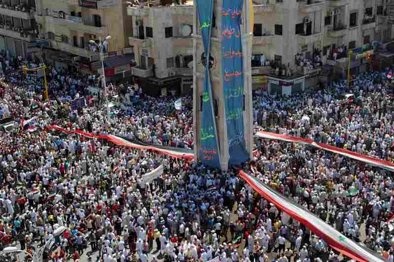 Syrians in the city of Hama staged a mass demonstration against the government on Friday, July 29, as seen in this photo provided to AFP by a third party. Two days later, the Syrian military launche