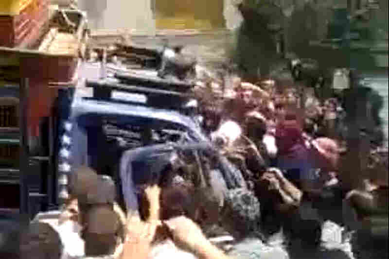Hama residents surround a truck that is transporting the body of a person killed in the fighting, according to the YouTube user who posted this video.