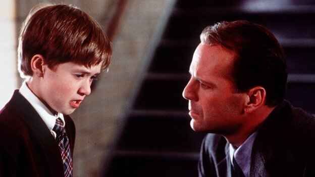 """Haley Joel Osment, left, and Bruce Willis appear in a scene from the film """"The Sixth Sense,"""" a tale of a child who can see ghosts."""