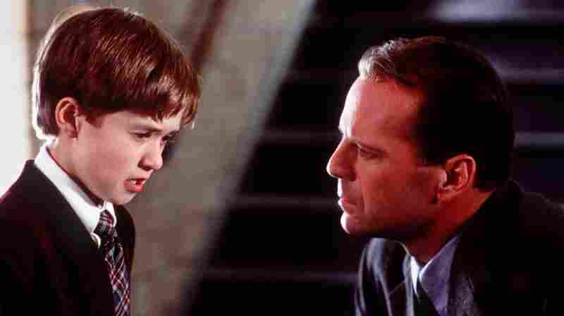 "Haley Joel Osment, left, and Bruce Willis appear in a scene from the film ""The Sixth Sense,"" a tale of a child who can see ghosts."