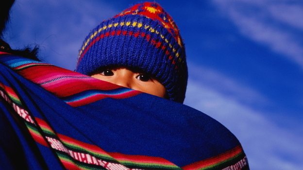 A young child wrapped in an aguayo, a traditional sling, on mother's back in La Paz, Bolivia. (Getty Images)
