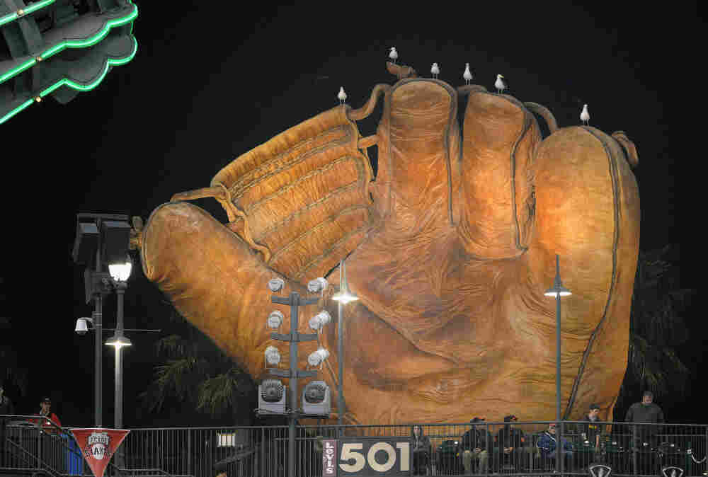 In San Francisco, gulls sit atop the large baseball glove behind the bleachers in left-center field during a game between the San Diego Padres and the San Francisco Giants. The gulls are known for arriving right at the end of games to pick up food scraps.