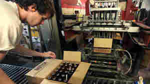 """Cellarman Cooper Reid packs cases of beer at the Ipswich Ale Brewery in July. New rules put out by the state's alcohol commission require """"farmer-brewers"""" like Ipswich to grow 50 percent of their own grains and hops, or get it from domestic farms."""