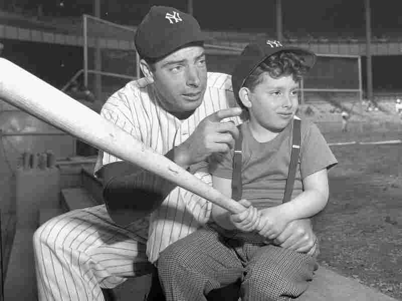 Joe DiMaggio of the Yankees passes on a few batting tips to his 5 1/2-year-old son, Joseph III, prior to the Yankees — Washington Senators game at Yankee Stadium, New York, April 27, 1947.