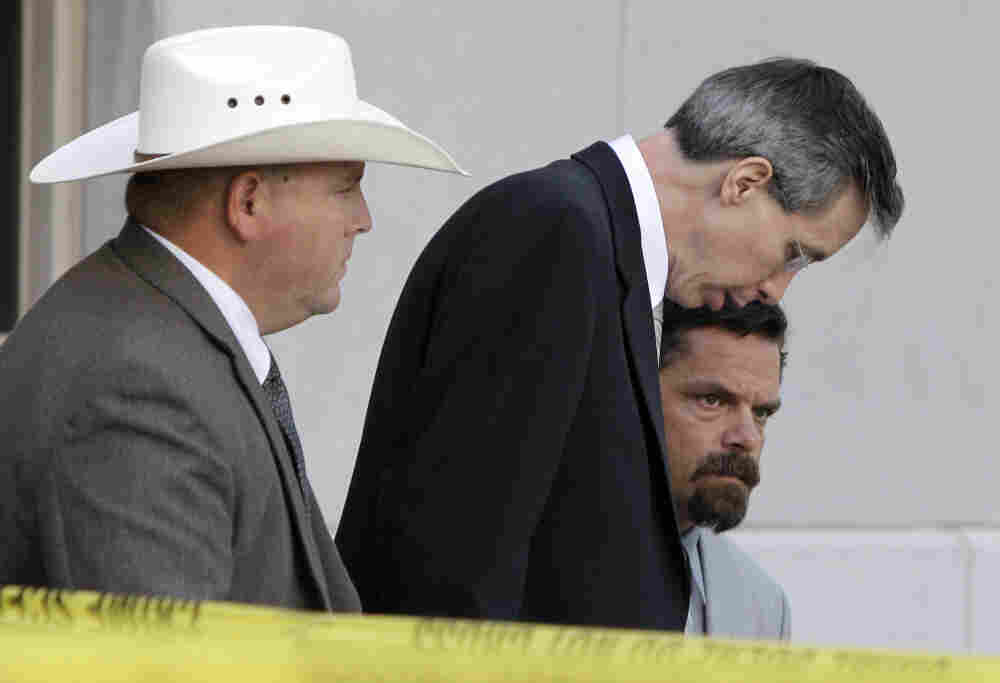 A law enforcement officer, left, escorts Polygamist religious leader Warren Jeffs, center, and his defense advisor Deric Walpole out of the Tom Green County Courthouse in San Angelo, Texas. A jury convicted Jeffs of child sexual assault Thursday.