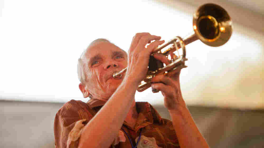 Trumpeter Dave Whitney performs with the New Black Eagle Jazz Band on the Harbor Stage at the Newport Jazz Festival.