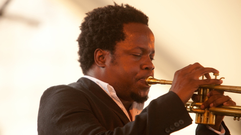 Ambrose Akinmusire performs with his quintet on the Harbor Stage during the Newport Jazz Festival. (Erik Jacobs for NPR)