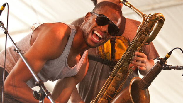 Trombone Shorty, with Dan Oestreicher on baritone saxophone in the background, performing at the Newport Jazz Festival on Saturday.