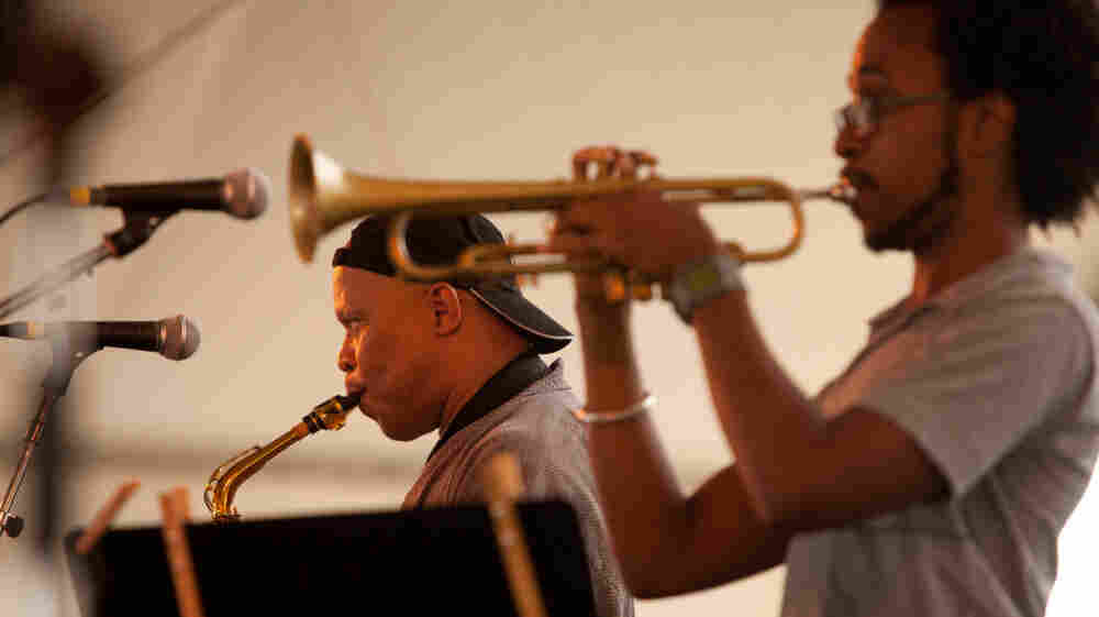 Steve Coleman performs with Five Elements, including Jonathan Finlayson (on trumpet, foreground), on the Harbor Stage at the Newport Jazz Festival.