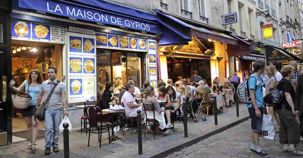 Restaurants line a street of the Quartier Latin in central Paris.
