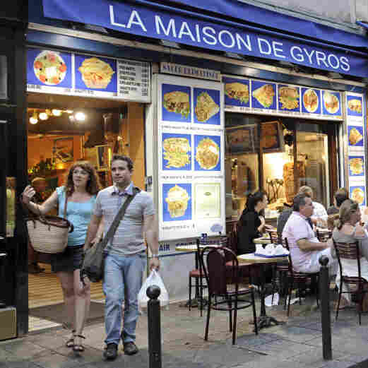 Restaurants line a street of the Quartier Latin in central Paris.