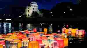 Paper lanterns to commemorate the victims of the bombing of Hiroshima float in the Motoyasu River in front of the Atomic Bomb Dome, in Hiroshima, Japan, on Saturday.