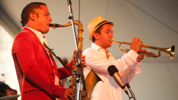 Mario Castro, left, performs with his quintet, including trumpeter David Neves, on the Harbor Stage during the Newport Jazz Festival.