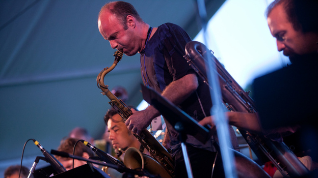 Dan Willis, on tenor saxophone, performs with the John Hollenbeck Large Ensemble on the Quad Stage during the Newport Jazz Festival. (Erik Jacobs for NPR)