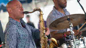 Joshua Redman, on saxophone, and Eric Harland, on drums, perform as half of James Farm on the Fort Stage during the Newport Jazz Festival.