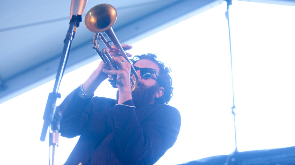 Avishai Cohen performs with his trio, Triveni, on the Harbor Stage during the Newport Jazz Festival. (Erik Jacobs for NPR)