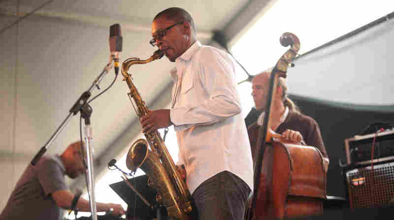 Ravi Coltrane performs with his quartet, including Luis Perdomo (left) and Drew Gress (on bass) on the Harbor Stage during the Newport Jazz Festival.