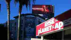 Hollywood's Query: Cowboys, Aliens, Smurfs Or Apes?