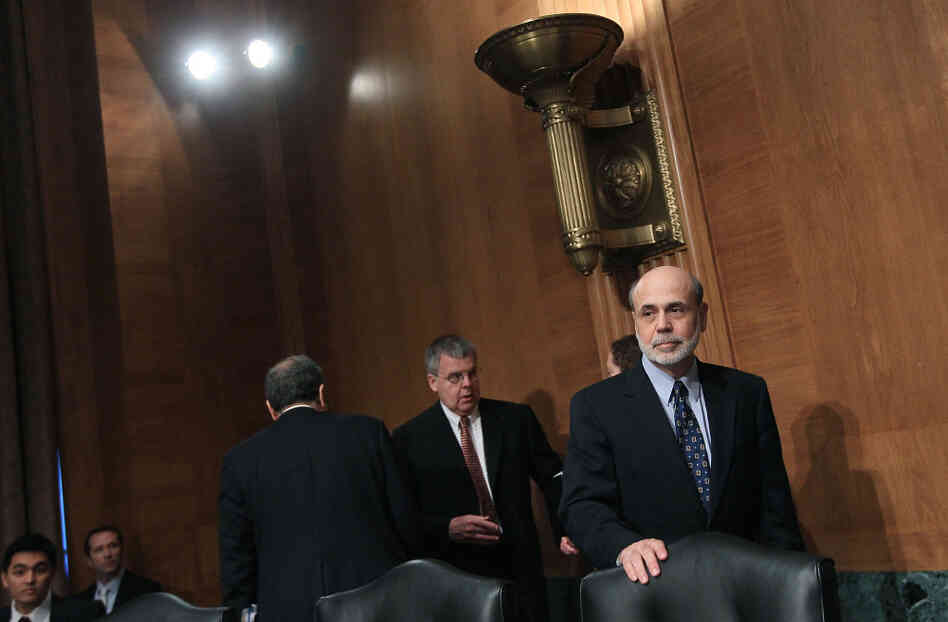 Federal Reserve Board Chairman Ben Bernanke may look to reassure global financial markets Tuesday. Here, he arrives for a Senate Banking, Housing, and Urban Affairs Committee hearing in July.