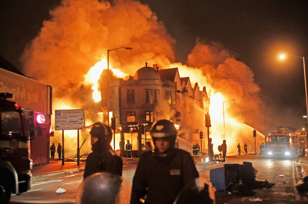 Firefighters battle a large fire that broke out in shops and residential properties in Croydon on August 9.