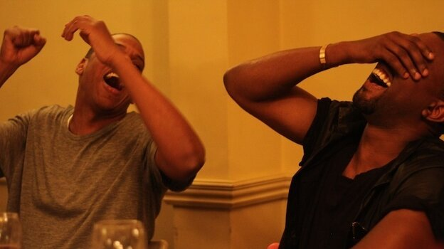 Jay-Z and Kanye West, laughing, from a series of photos on Jay-Z's web site taken during the making of Watch the Throne.