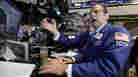 Michael Pistillo, right, works with a fellow specialist on the floor of the New York Stock Exchange Tuesday, Aug. 9, 2011.