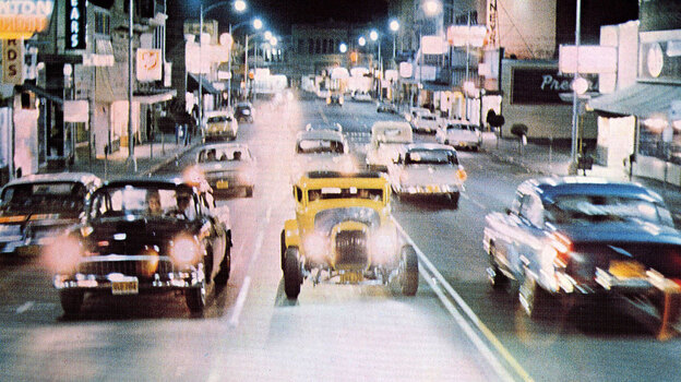 Cruising on Main Street: A scene from George Lucas's 1973 film American Graffiti.