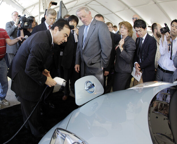 Nissan President and CEO Carlos Ghosn (front left) plugs a charger into the all-electric Nissan Leaf at the groundbreaking ceremony for the company's lithium-ion battery plant in Smyrna, Tenn., in May 2010. The United States remains the world's leading recipient of foreign direct  investment.