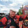 "Author Ken Kesey poses in 1997 with his bus, ""Further,"" a descendant of the vehicle that carried Kesey and the Merry Pranksters on the 1964 trip immortalized in Tom Wolfe's book The Electric Kool-Aid Acid Test. Kesey, who died in 2001, is the subject of the new documentary Magic Trip."