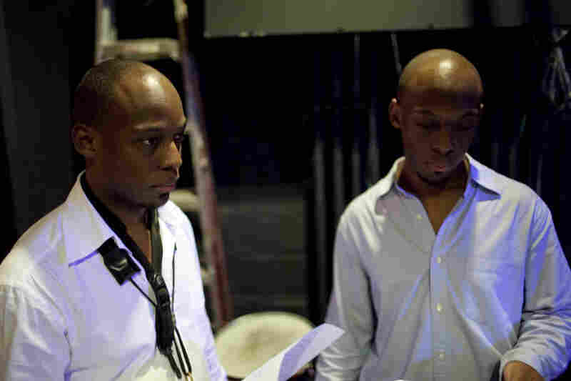 Marcus Strickland (left) with his twin brother and drummer, E.J. Strickland.