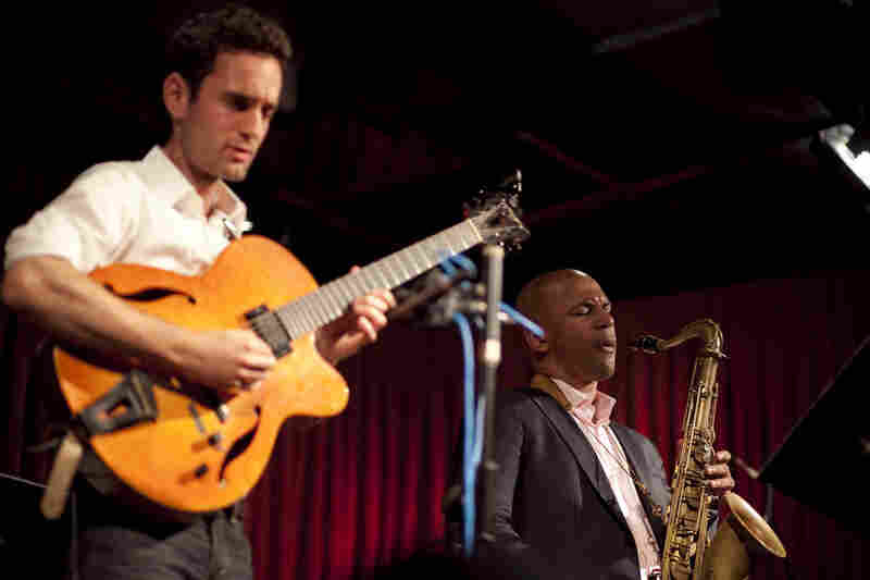 Julian Lage (left) and Walter Smith III, performing with Eric Harland's Voyager.