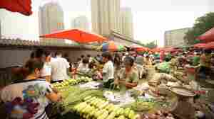 China said its politically sensitive inflation rate hit a 37-month high of 6.5 percent in July. Food costs, rose by 14.8 percent from a year ago, according to reports. Above, people shop for produce at a Beijing market Tuesday.