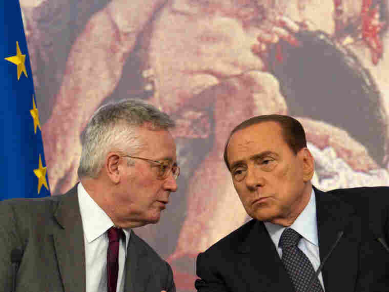 Italian Premier Silvio Berlusconi (right) and Finance Minister Giulio Tremonti at a news conference in Rome on Aug. 5. The European Central Bank has agreed to help Italy with its debt crisis but is demanding tough austerity measures.