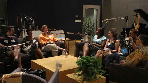 Adam Graham (from left to right), Tanae Foglia, Kelly Hruska, Stacey Ferguson, Corie Driscoll, Angela Tilghman and Sharon Johnson participate in a round-table discussion about parenting hosted by Michele Norris at NPR's headquarters in Washington, D.C.