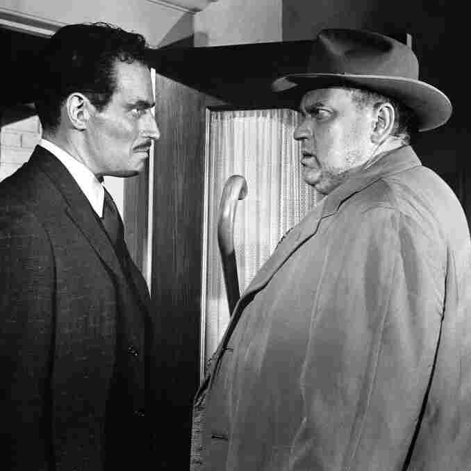 Charlton Heston (left) as Miguel Vargas and Orson Welles as Hank Quinlan in Touch of Evil
