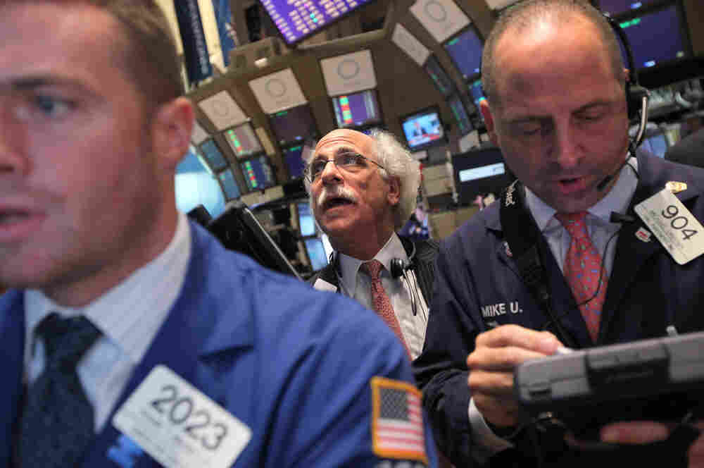Traders work on the floor of the New York Stock Exchange on Wednesday. Wall  Street is in the midst of the biggest stock sell-off since the financial crisis  a few years ago.
