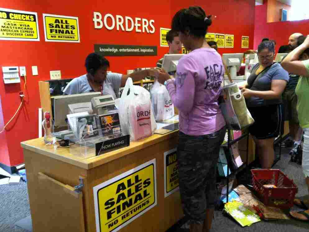 Customers are taking advantage of the liquidation sale at Borders in Silver Spring, Md., Saturday July 23, 2011. Borders Group Inc., America's second-largest bookstore chain, announced mid-July that it is closing.