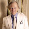 Author Tom Wolfe poses in one of his trademark three-piece suits.